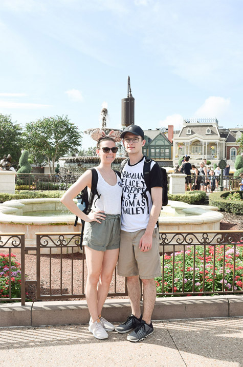 Magic Kingdom Trip_Alex and Cait in front of fountain